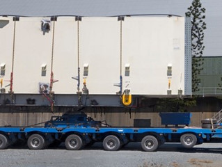 How do you transport an awkward quasi-trapezoidal shape that's over 21m long, 6.3 m wide, 6.5 m