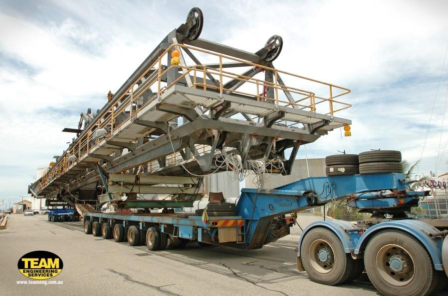Truck loaded for hay point shiploader boom transport