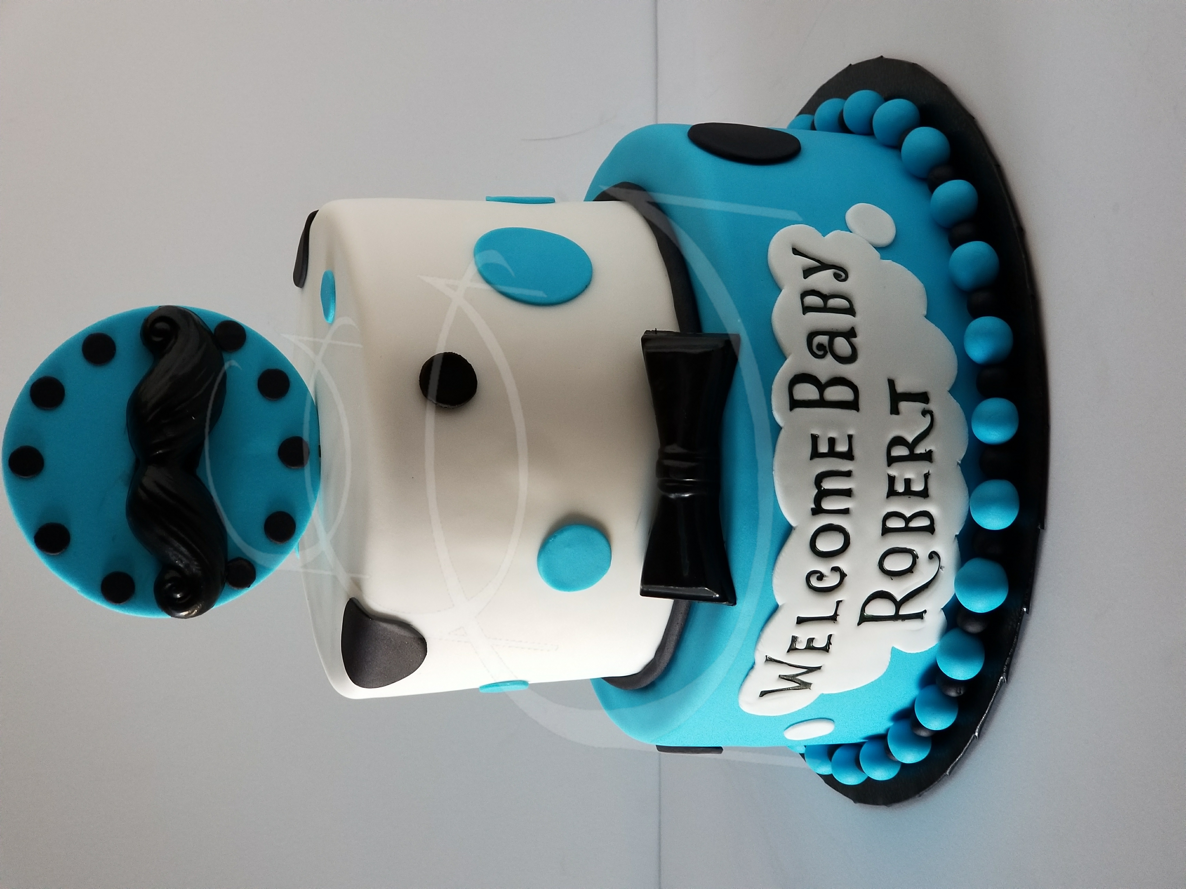 Mustache and bows baby shower cake