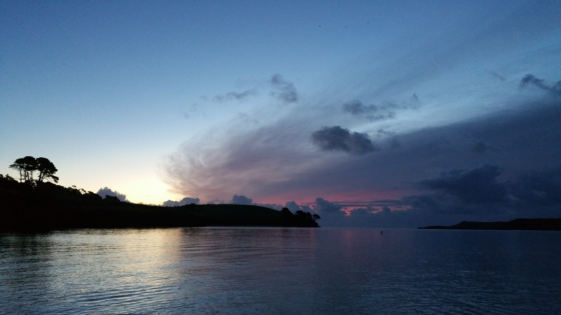 A morning swim, sunrise. Looking East through the mouth of the Helford River.