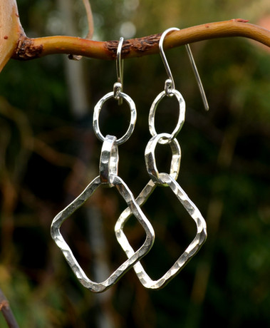 Handmade hammered sterling silver earring