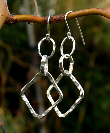 Handmade hammered sterling silver earring