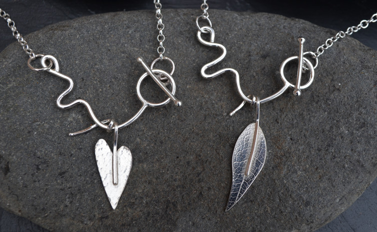 Leaf and heart printed silver necklace