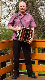 Mally holding Hohner melodeon.