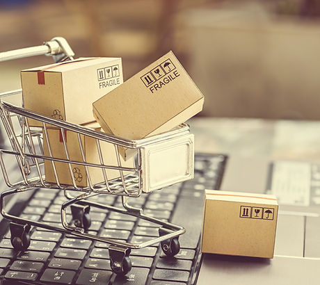 Paper boxes in a shopping cart on a lapt