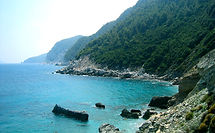 View along the coast of Skopelos. Villa for rent in Greece, Skopelos, with a swimming pool and free wifi.