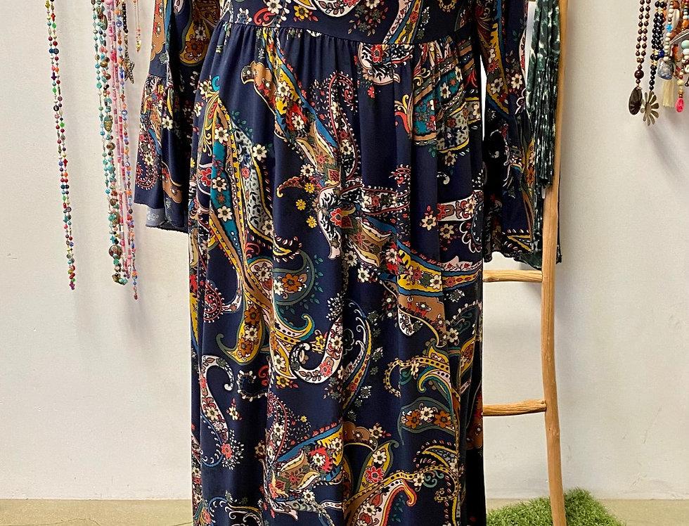 Lang kleed met franjes en pompons