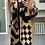 Thumbnail: Lange jas camel met zwarte motieven
