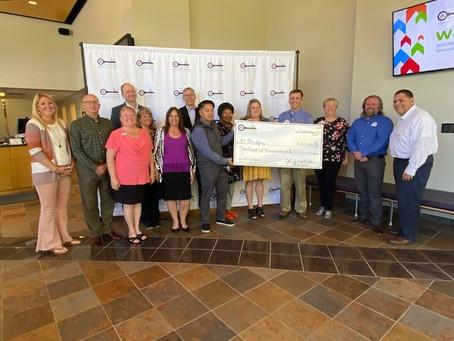 REALTORS® Charitable Foundation Presents Check To Bridging