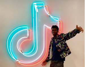 Lil Nas X celebrates at TikTok HQ