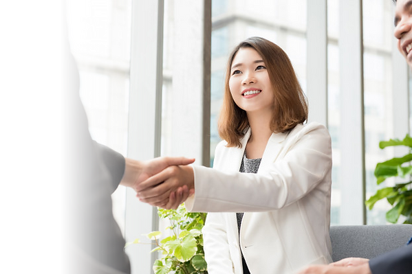 asian-business-woman-making-handshake-wi