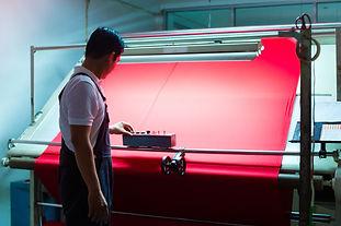 asian-worker-controls-fabrics-textile-pl