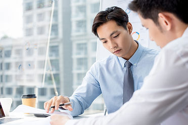 businessman-seriously-discussing-project