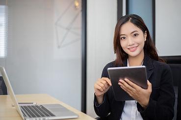 asian-business-women-using-tablet-workin