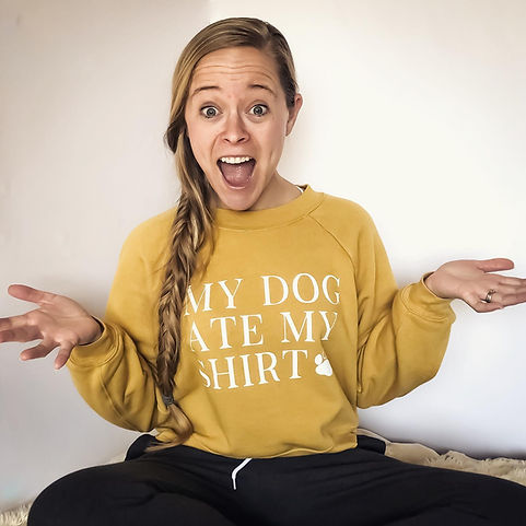 """Christa (blonde women with long right-side braid) wearing """"my dog ate my shirt"""" cropped sweatshirt in heather mustard color"""