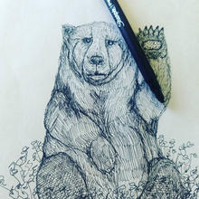 Bearwithinkonpaperfacingyouandwaving