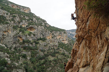 Nettie the owner rock climbng her first 7a lead