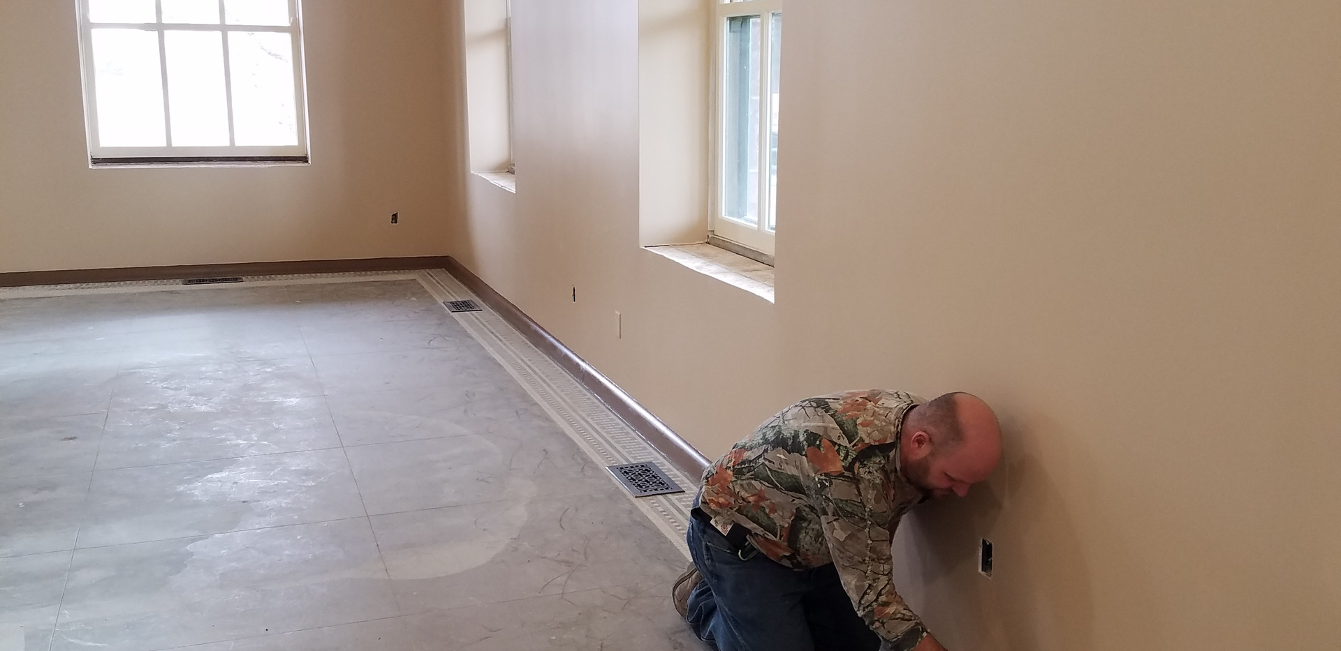 Joe painting baseboard 01122018.jpg