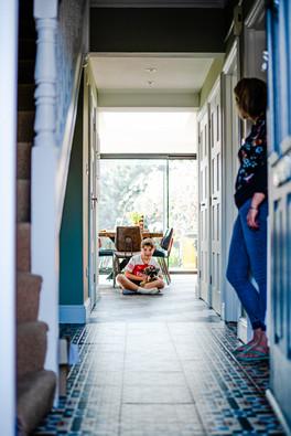 Boy and dog in hallway.jpg