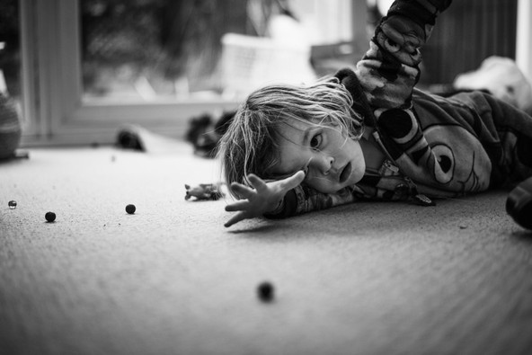 Boy playing with marbles.jpg
