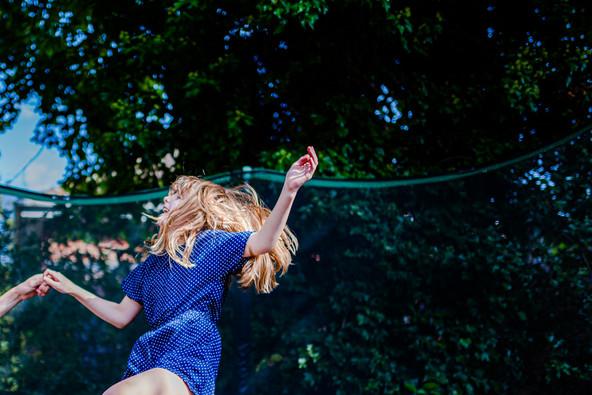 Girl bouncing on trampoline.jpg