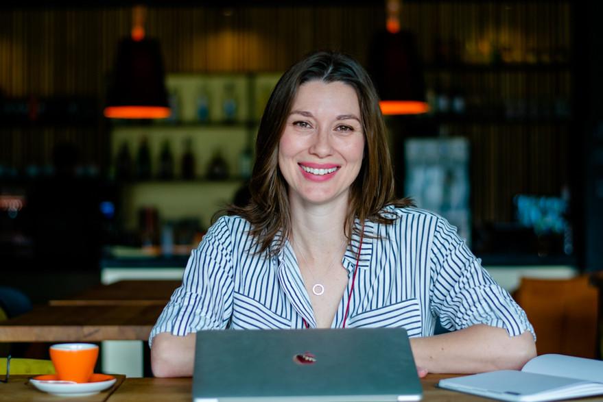 Female entreprenuer headshot with laptop