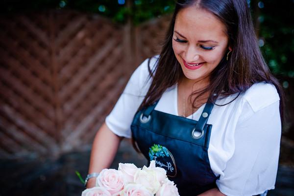 Female branding portrait florist with fl