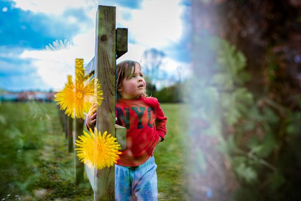 Multi exposure boy by fence.jpg
