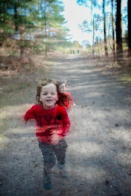 Boy running in wood.jpg