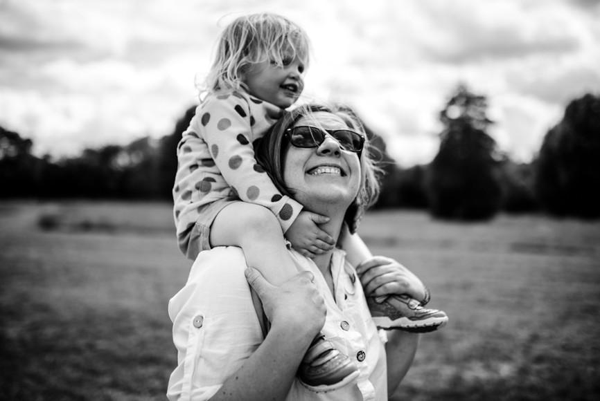 Mum and daughter on shoulders portrait.j