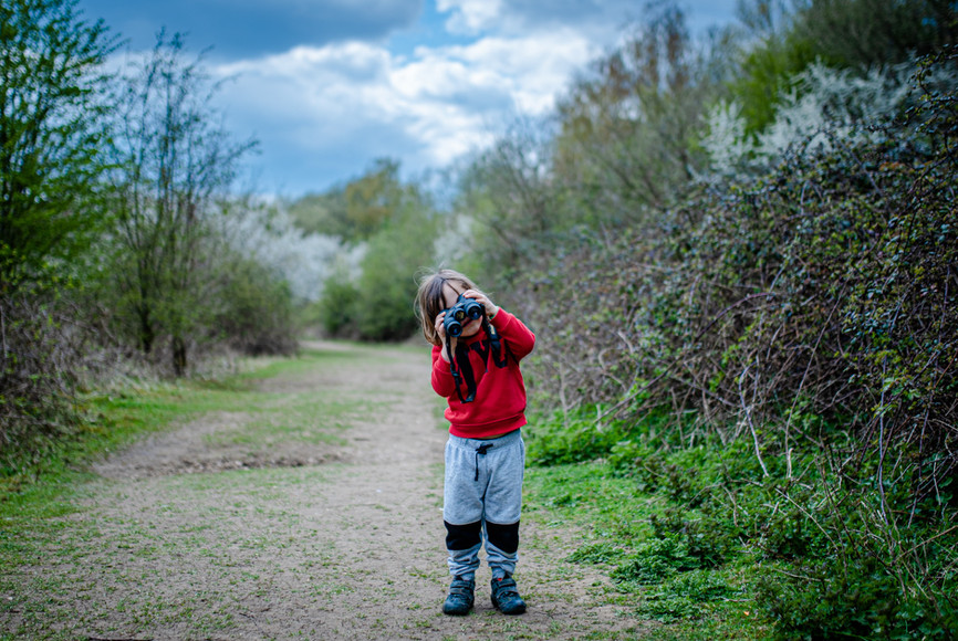Child playing with binoculars.jpg