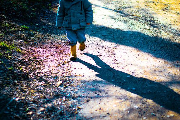 Boy in wellies walking.jpg