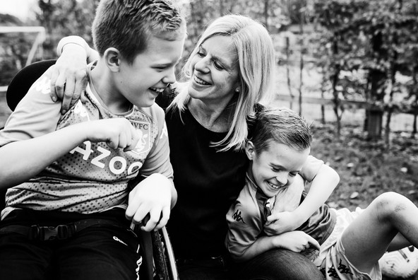 Mother and sons black and white portriai