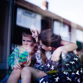 Sibling portrait through window.jpg