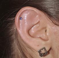 пример прокола мочки уха