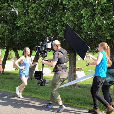 Action shot of (right to left) Grace Hannoy (actor/writer/producer), Megan Masur (Steadicam Op), and Julia Gowesky (Key Grip)