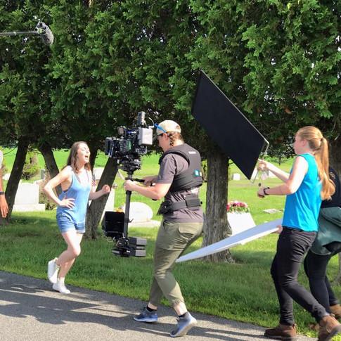 Action shot of (right to left) Grace Hannoy (actor/writer/producer), Megan Masur (Steadicam Op), and Julia Gowesky (Key Grip)