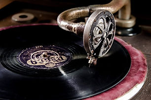 78s: Photo of 78 RPM shellac record album playing on a gramophone.