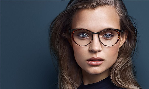 woman wearing high fashion designer glasses