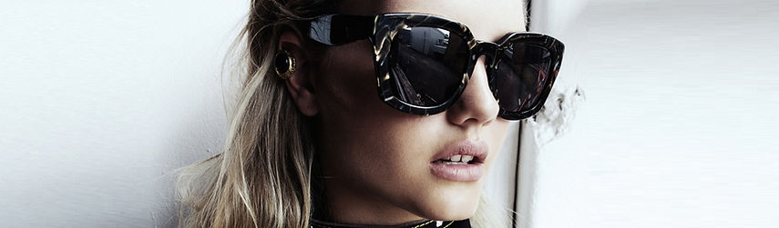 woman wearing high fashion designer sunglasses