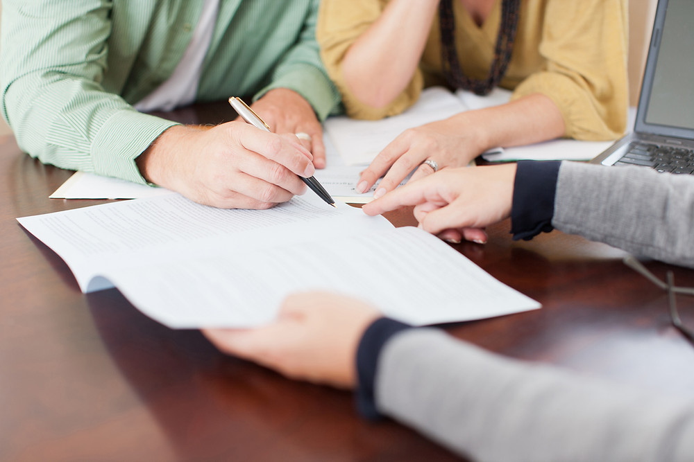 Couple signing real estate contract