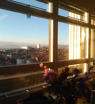 Glasgow from Gartnavel Hospital Window. The sun shines a golden colour.