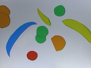 Brightly coloured, flat shapes arranged on a pale grey background.