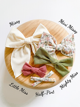 A flatlay showing all five available fabric bow styles