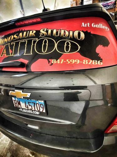 Vehicle Wrap -  Window Perf Dino Tattoo.