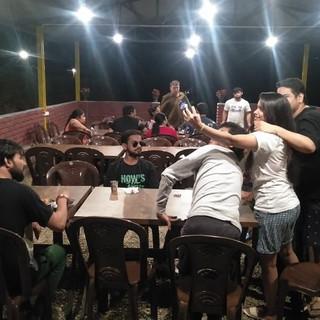 group enjoying in dining camping bhimtal.jpg