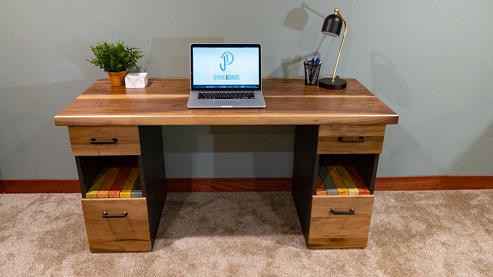 This is a custom walnut desk we built for a client. It has a solid walnut top and colorful slats for shelves.
