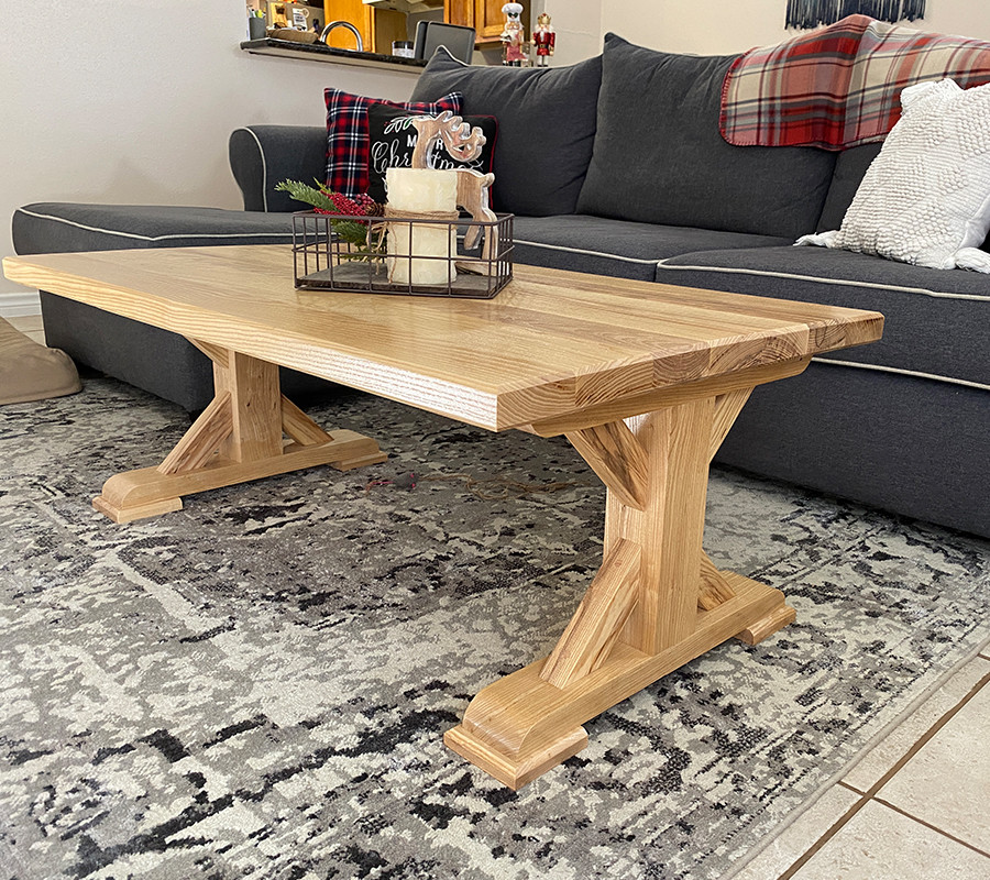 This is a solid ash farmhouse coffee table.