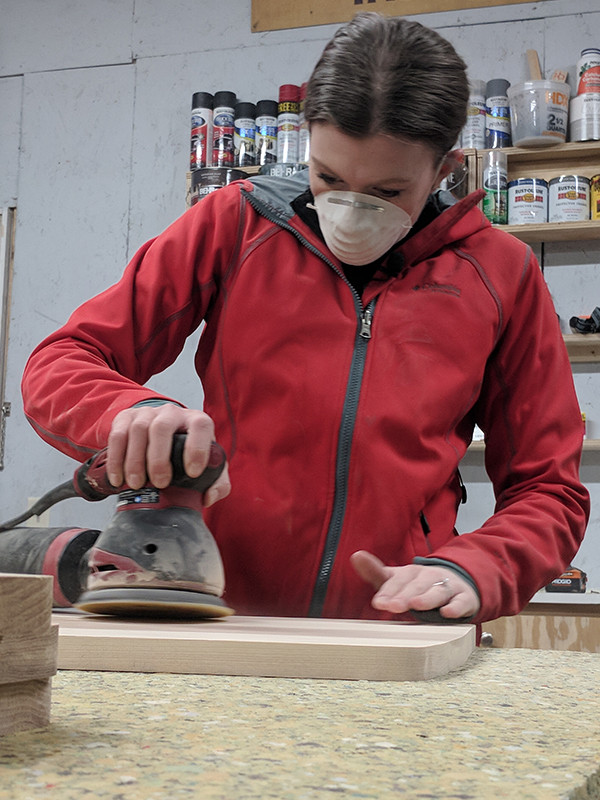 After sanding, we used the router to round over the edges.