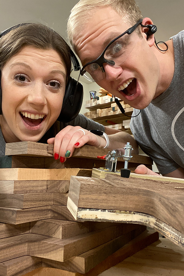 This is a picture of Jennie and Davis with big smiles. Our new jig for charcuterie boards worked really well and we were very happy about it!